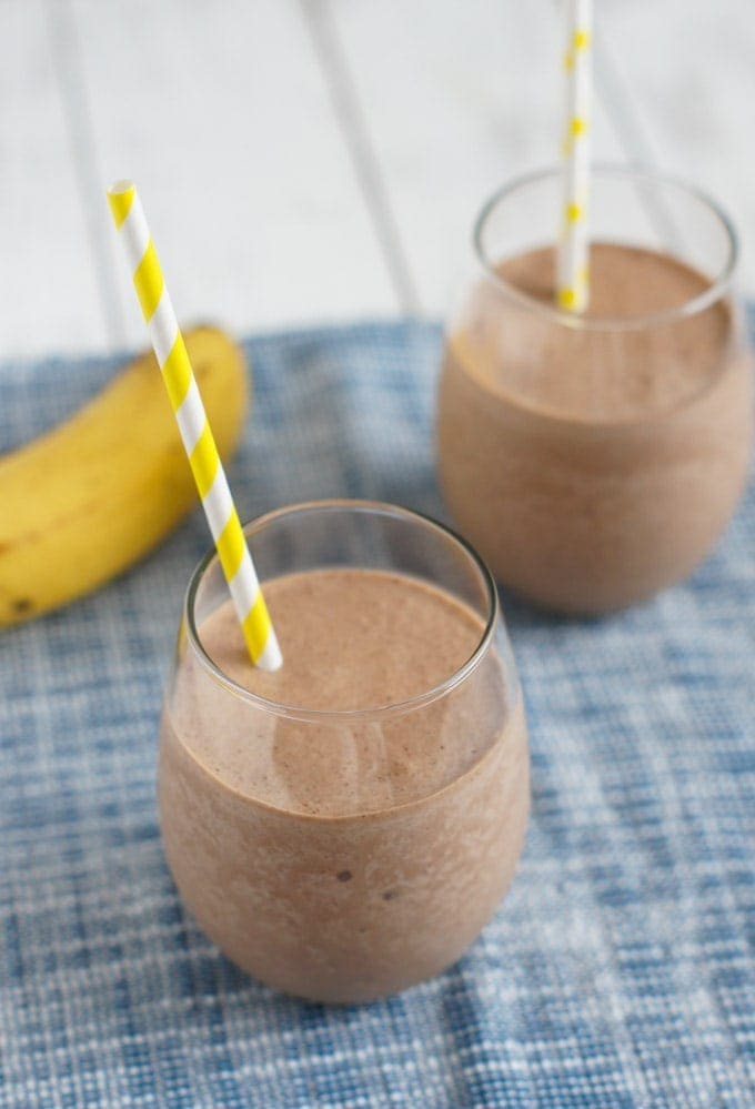 Banana Nutella Milkshake in clear drinking glasses.