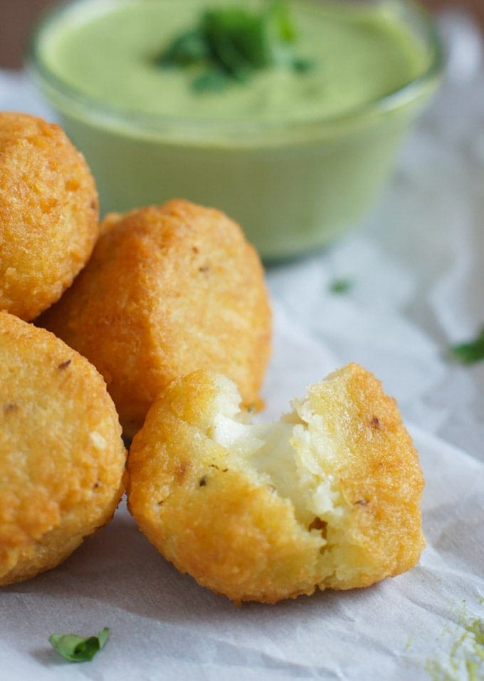 Yuca Balls Stuffed with Cheese and cilantro dressing on the side