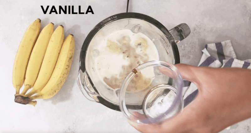 Vanilla being added to the blender with banana, Nutella and milk.