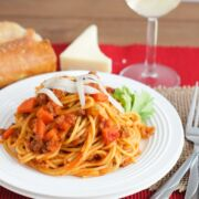 Spaghetti and meat sauce served on a white plate.