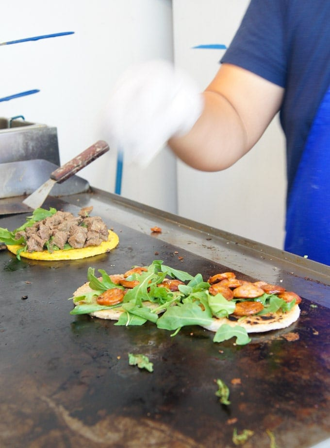 Food being prepared on a griddle.