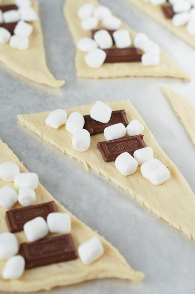 Chocolate and marshmallows on top of a triangle of pastry dough.