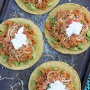 Overhead shot of four tostadas with chipotle chicken topping.