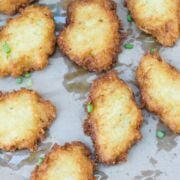 Yuca fritters on a foil lined tray.