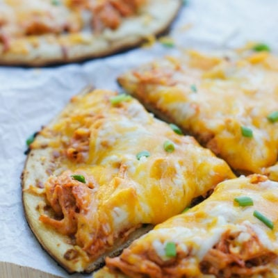 Cheesy, crispy, spicy and full of flavor! The perfect Game Day Buffalo Chicken Mini Pizza.