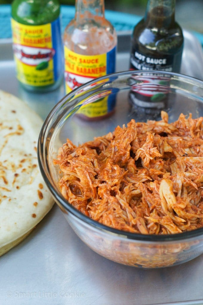 The buffalo shredded chicken in a glass bowl.