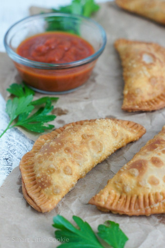Pepperoni Pizza Empanadas with marinara sauce on the side