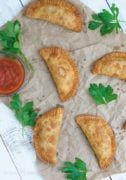 Pepperoni Pizza Empanadas - Crunchy on the outside, cheesy and gooey on the inside. The perfect easy snack or appetizer for any occasion.