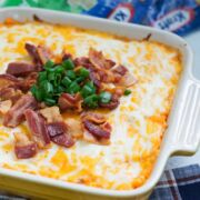 Smooth, cheesy and loaded with bacon, this easy loaded sweet potato casserole is the perfect side dish to place on your table these holidays.