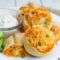 Spicy, cheesy and absolutely delicious, this super easy buffalo chicken rolls are the perfect snack to share with your guest on Super Bowl night.