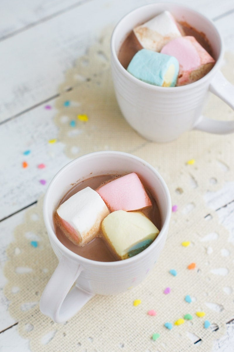 Hot chocolate drink served in a white mug.
