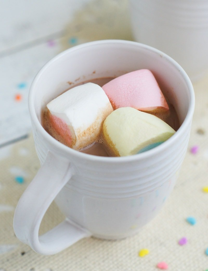 Close up of the marshmallows floating on top of a hot chocolate.