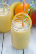 Tropical Sunrise Smoothie ~ A protein packed and refreshing smoothie filled with vitamins, potassium, and lots of tropical tasting flavors!