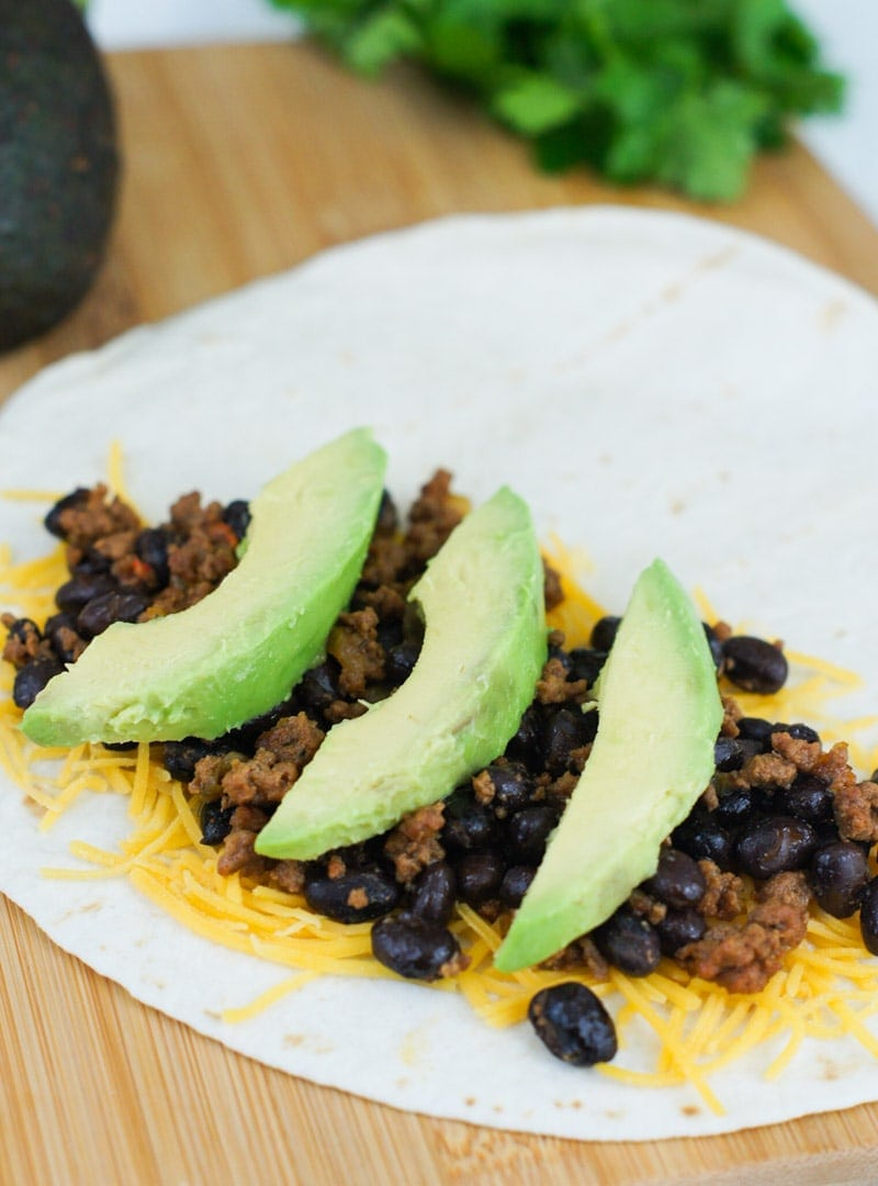 This 20-minute Black Beans, Beef and Avocado Quesadillas is a quick and easy dinner perfect for those busy after work nights.