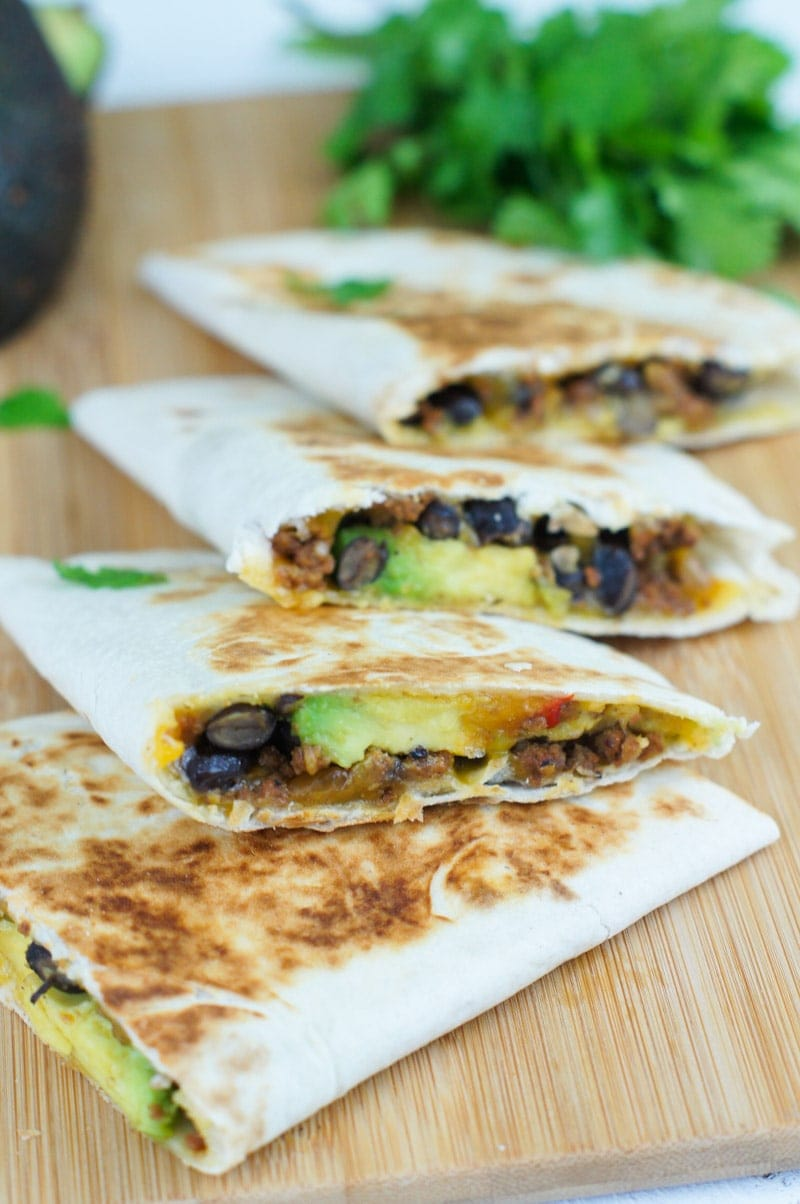 Close up showing the avocado and black bean filling in the quesadillas.