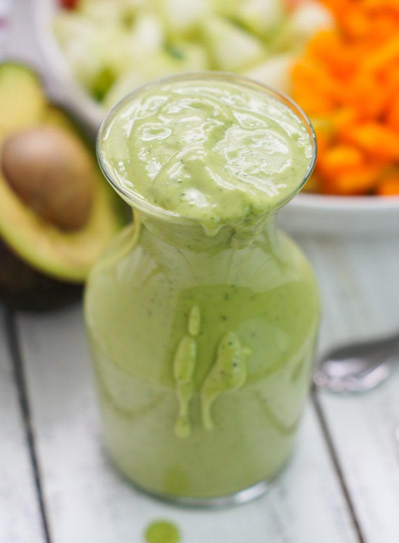 Creamy avocado cilantro dressing in a jar.