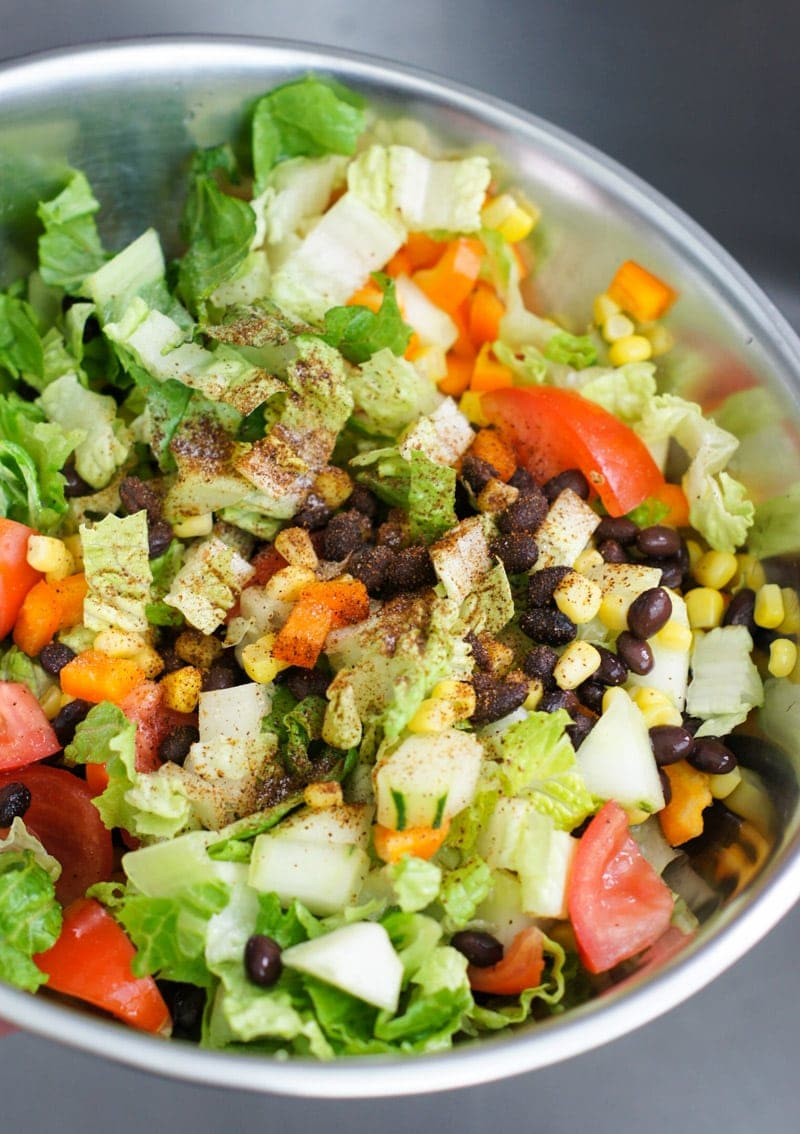 Close up of the salad ingredients tossed together.