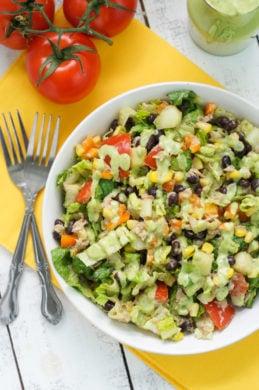 Tuna black bean chipotle salad served in a white bowl.