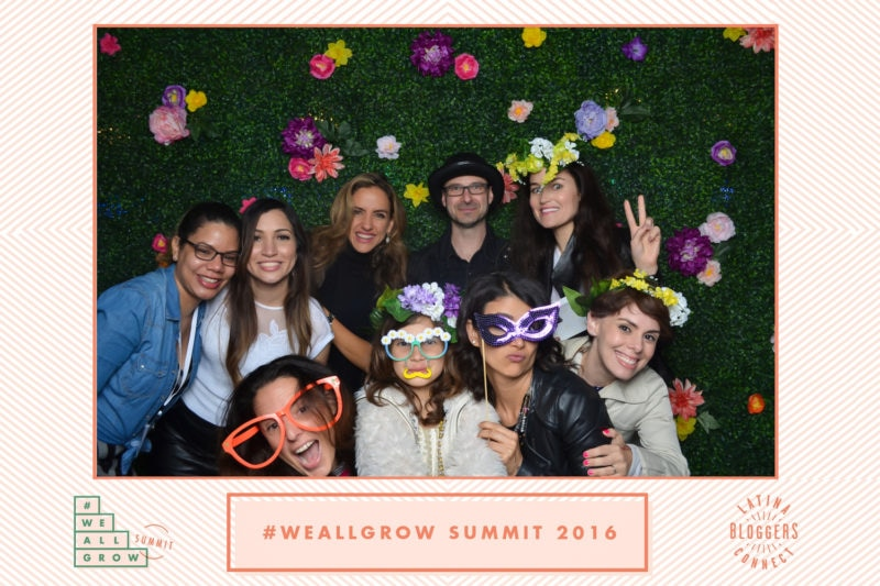 Nine people posing for the camera, some wearing novelty glasses.