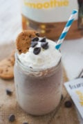 A chocolate chip cookie smoothie topped with whipped cream.
