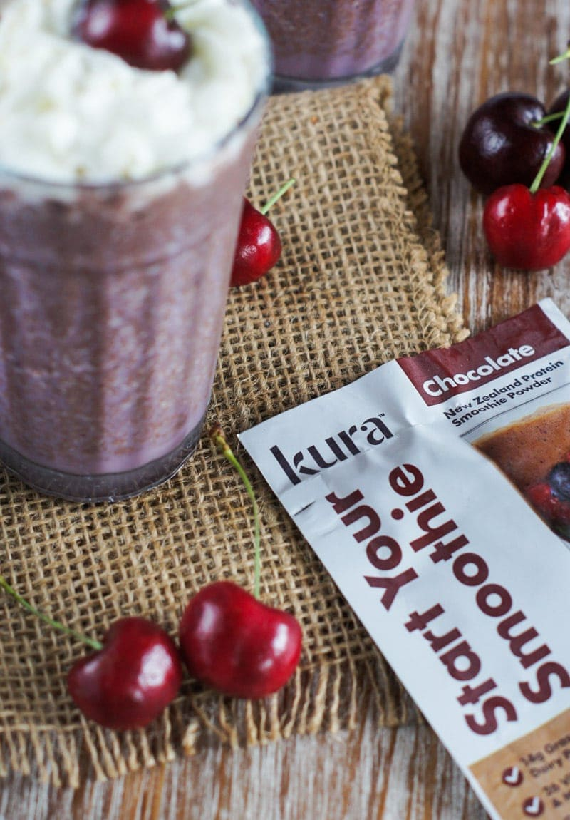 This Black Forest Protein Smoothie is filled with cherries and delicious chocolate, and topped with whipped cream for an indulgent smoothie that is good for you!