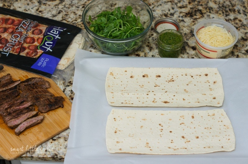 Flatbreads next to other ingredients.