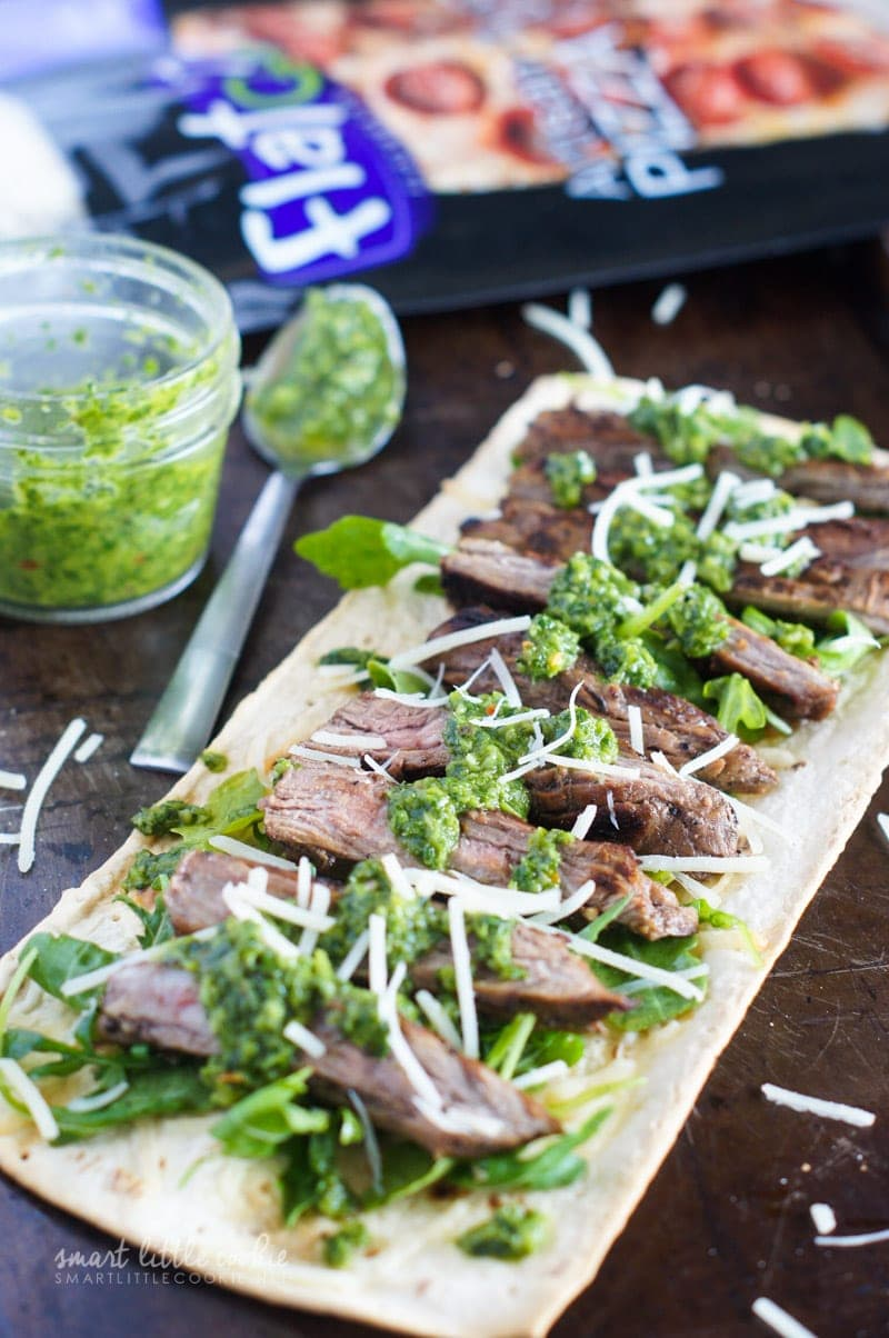 Steak on the flatbread and topped with chimichurri and parmesan.