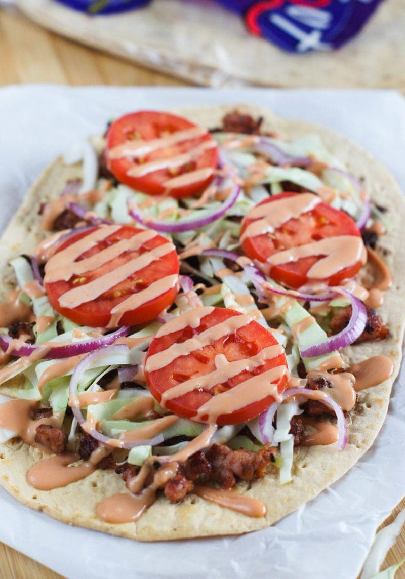 Easy Dominican Style Flatbread Chimi Pizza ~ Inspired by the popular Dominican burger, Chimi, traditionally served by street vendors in the Dominican Republic, this pizza is made with flatbread, sausage, cabbage, onions, tomatoes and a mayo-ketchup sauce. www.mydominicankitchen.com #pizza #ad #FlatoutLove