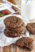 Five chocolate peanut butter cookies stacked on top of each other.
