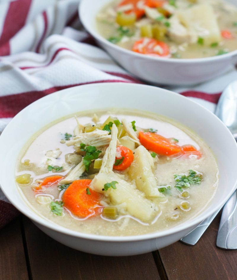Slow Cooker Chicken Noodle Soup with Yuca on a white bowl