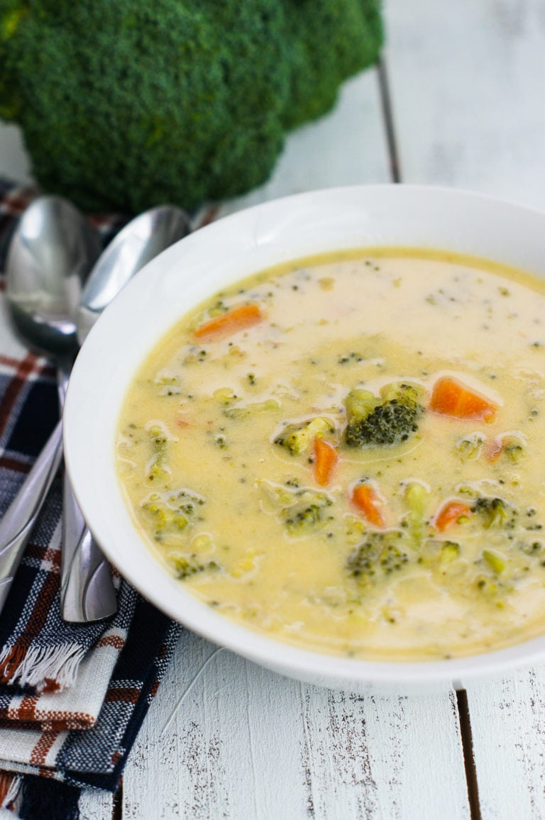 A simple cheese broccoli soup recipe that is easy to make and filled with delicious cheddar cheese, broccoli and carrots. mydominicankitchen.com #soup