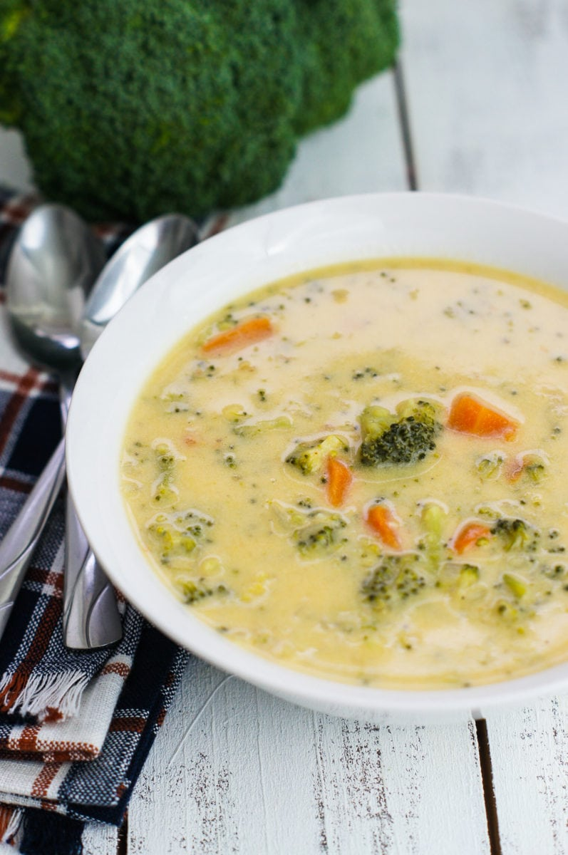 A simple cheese broccoli soup served on a white bowl
