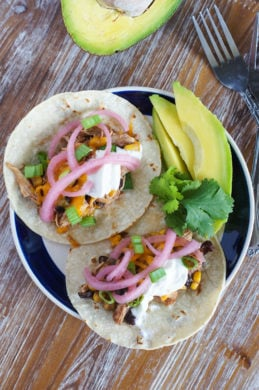 Chicken Chili Tacos ~ The easiest, quickest and most flavorful tacos made with the best leftover slow cooker chicken chili, corn tortillas, avocados, pickled onions and sour cream.