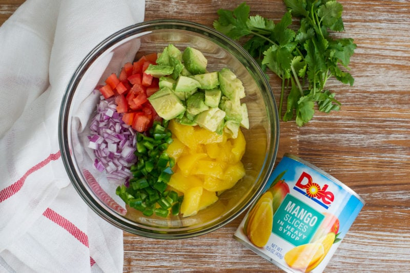 Cuban Style Quinoa Salad with Mango Avocado Salsa ~ A quick and delicious salad for the busy parent on-the-go made with quinoa, black beans, sweet plantains, mixed greens and a yummy mango avocado salsa. #VidaDole #salad #ad www.mydominicankitchen.com
