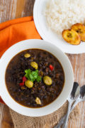 Quick and easy Dominican Black Beans Stew made with garlic, onions, bell pepper, cilantro and olives. The perfect dish to pour over rice! #quickmeal www.mydominicankitchen.com