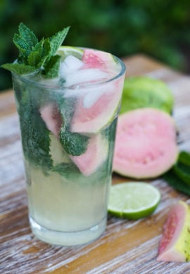 Sweet, refreshing Guava Mojito made with limes, guava nectar, rum and mint leaves. The perfect poolside Summer tropical cocktail to enjoy with friends. #Summer #cocktail www.smartlittlecookie.net
