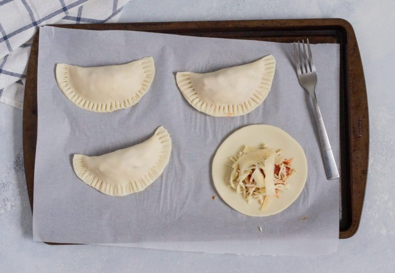 The empanadas being folded over.