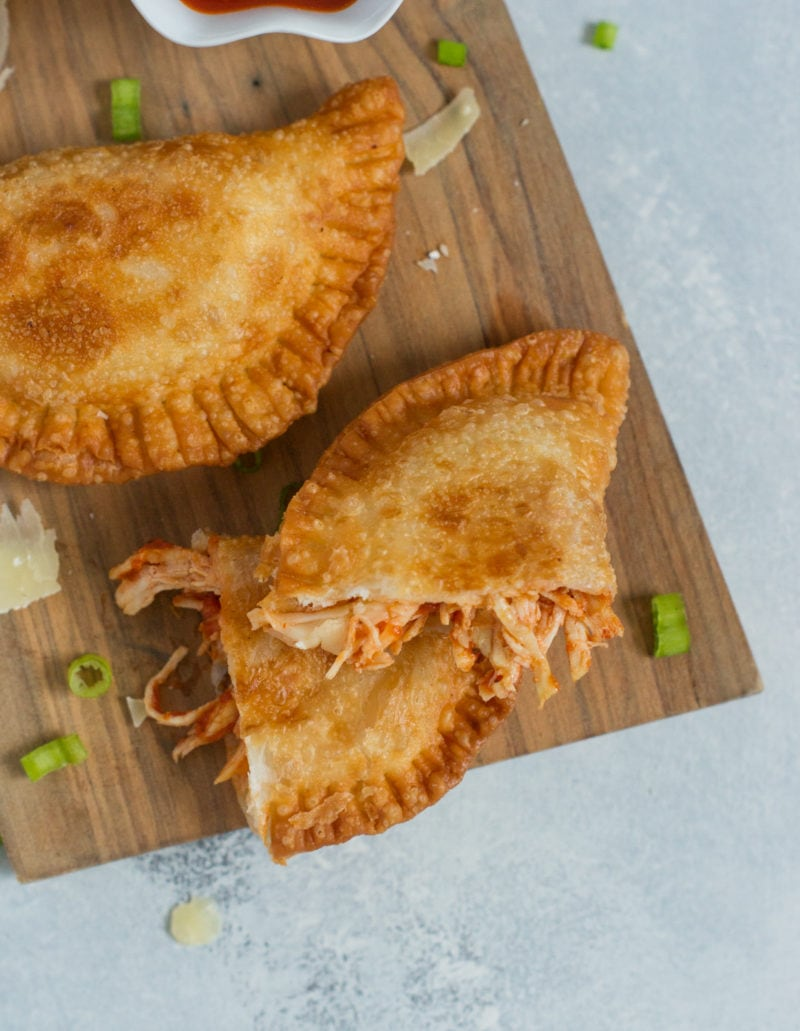 These delicious and easy chicken Parmesan empanadas are stuffed with traditional tomato sauce, chicken, mozzarella and Parmesan cheese. A fun and kid-friendly recipe perfect for Back-to-School. #ad