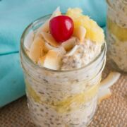 Pina colada overnight oats topped with a cherry.
