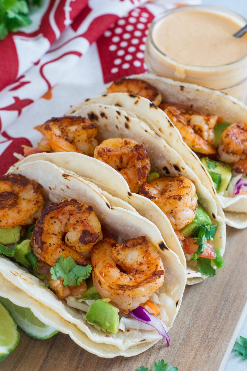 Three shrimp tacos before being drizzled with the chipotle sauce.