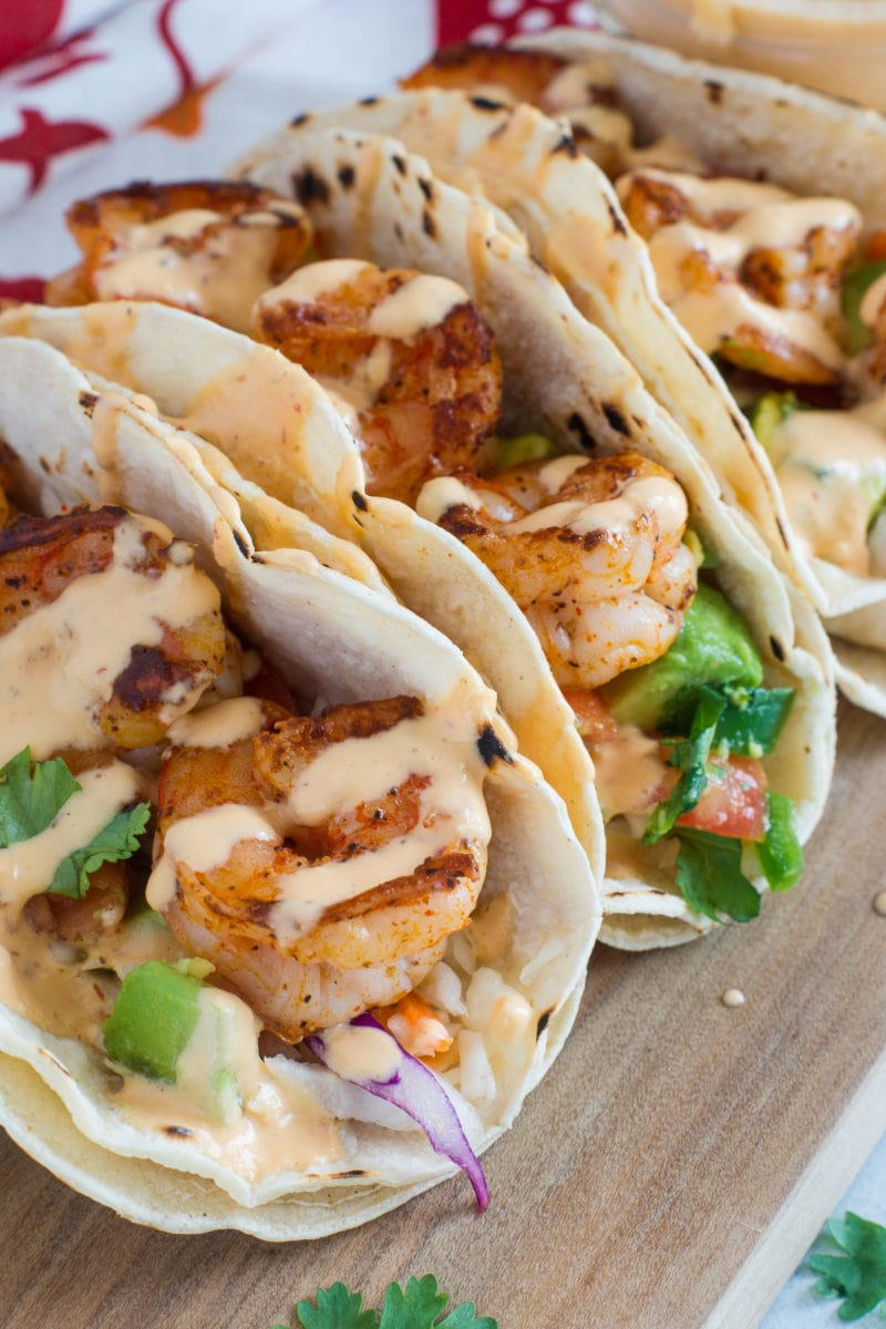 Close up of the shrimp in tacos drizzled with the pineapple chipotle sauce.