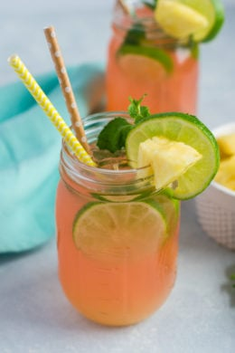 Cherry Pineapple Mojito ~ A fun and refreshing cocktail made with limes, pineapple juice, rum, mint leaves and 7UP® Cherry. #ad #MixItUpaLittle