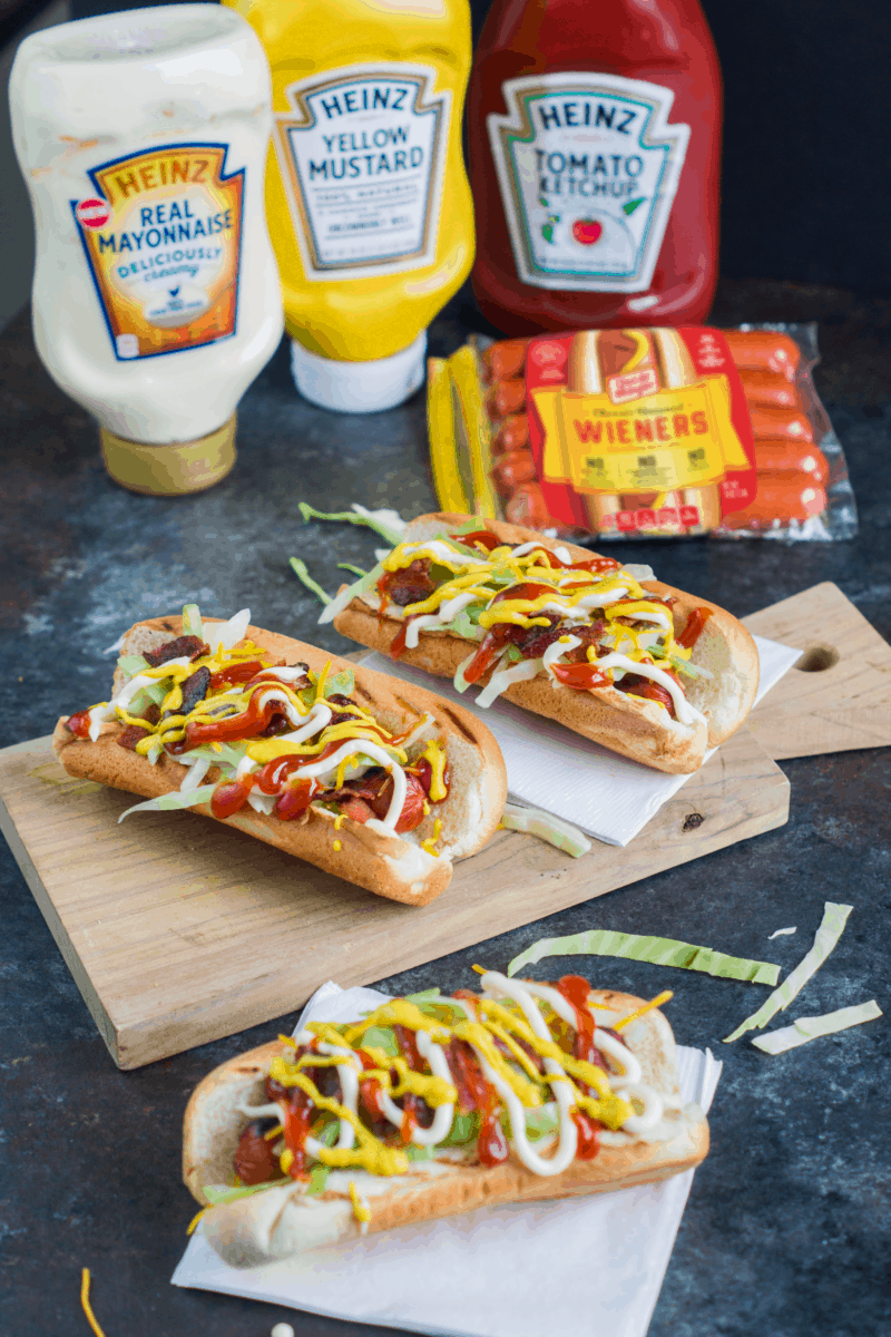 Topped with cheese, bacon, shredded cabbage, mayo, ketchup and mustard, these Dominican Style Hot Dogs are perfect for a Memorial Day cookout or any grilling occasion.