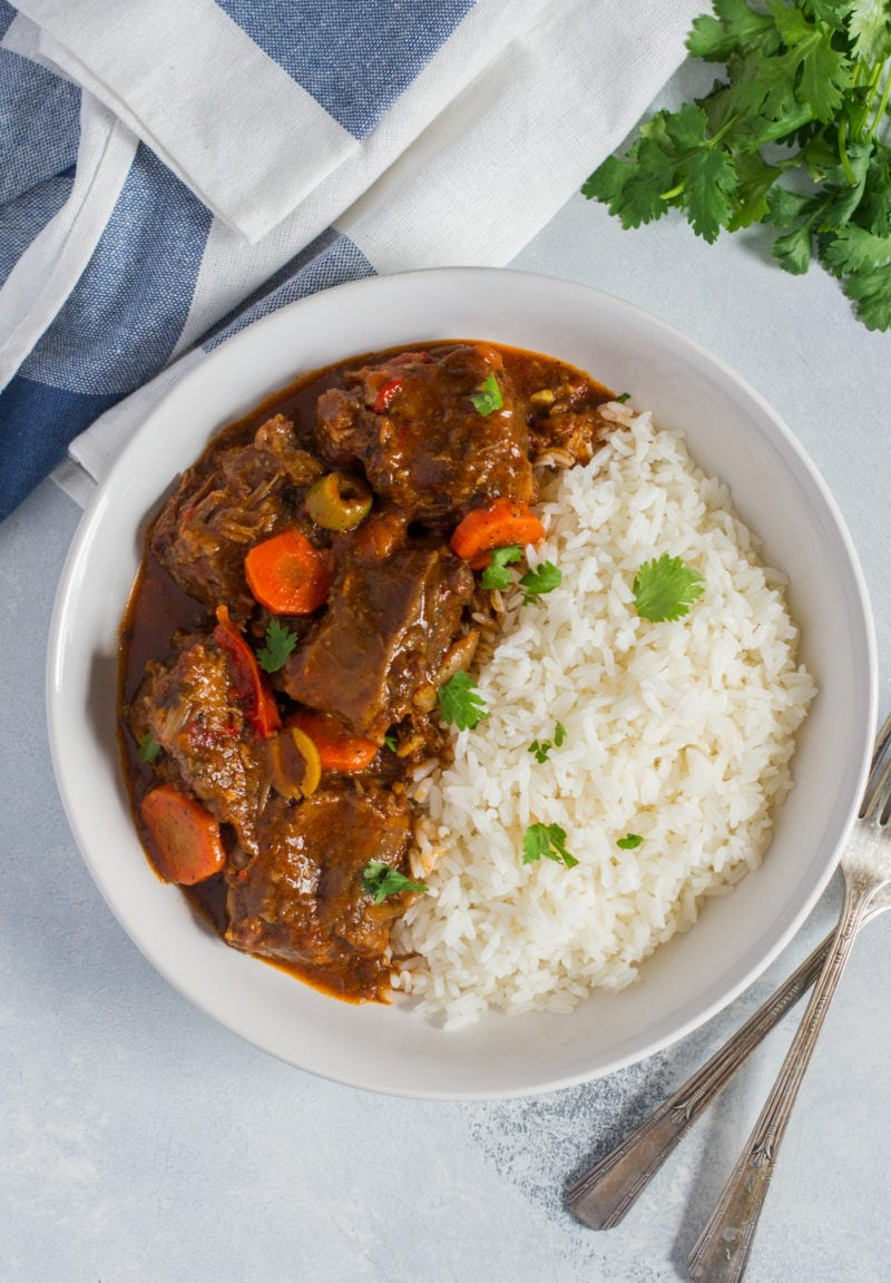 Traditional Dominican Style Spicy Oxtail Stew (Rabo Encendio) served with white rice