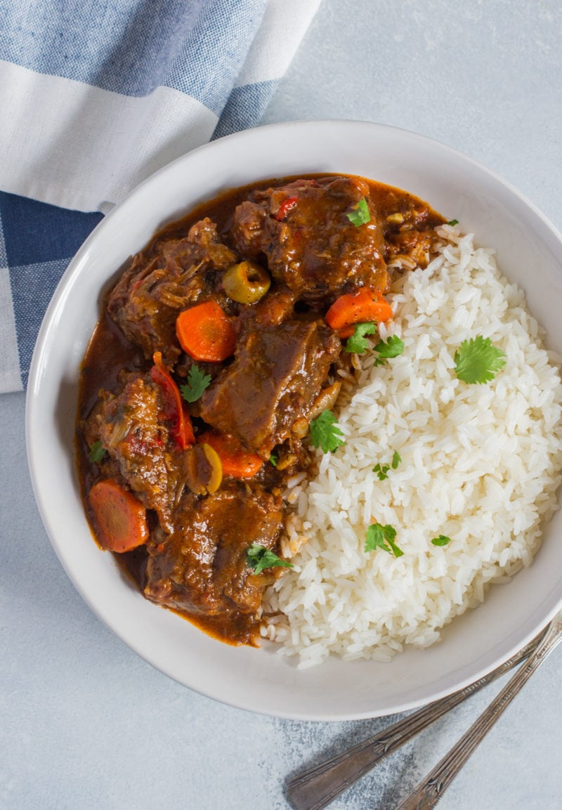 Overhead shot of Rabo Encendio served with rice