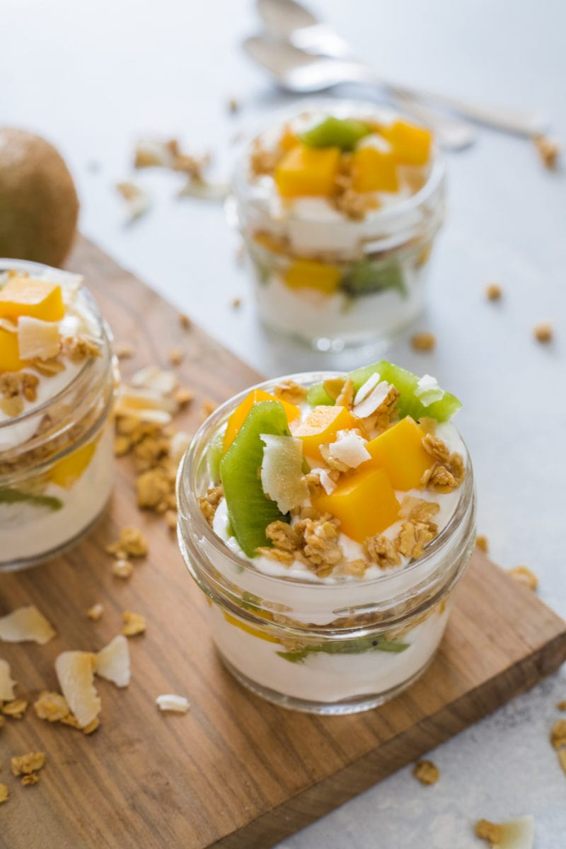 A yogurt parfait topped with fresh fruits and nuts.