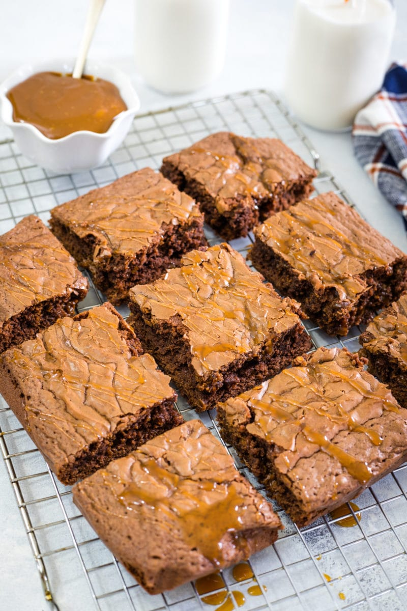 Nine brownie squares on a cooling rack.