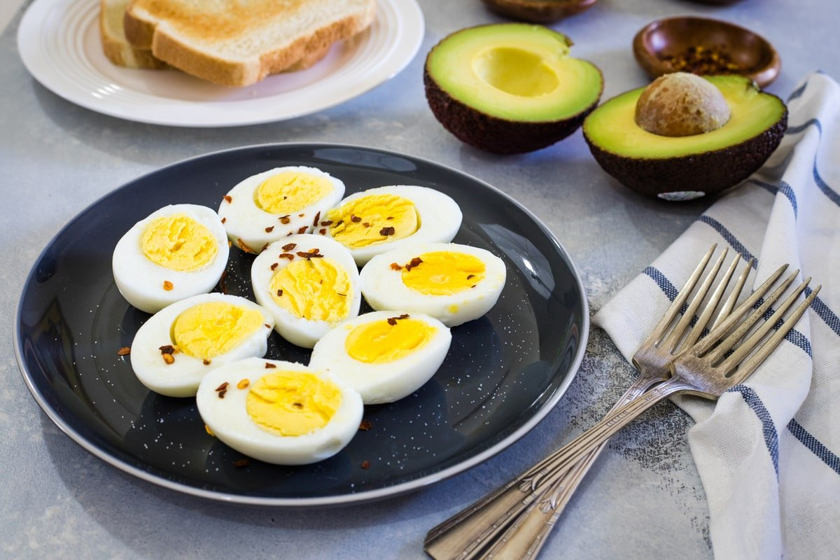 Hard boiled eggs on a black plate