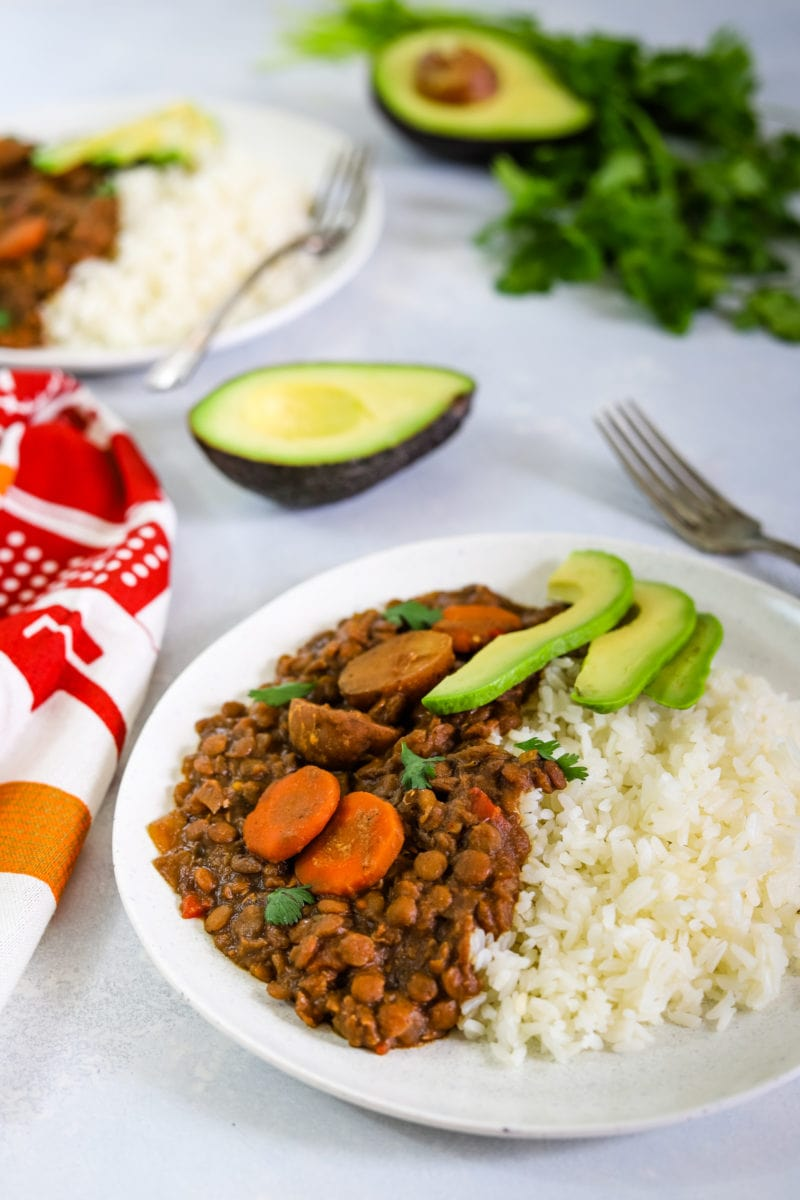 Lentil stew served with rice on a white plate