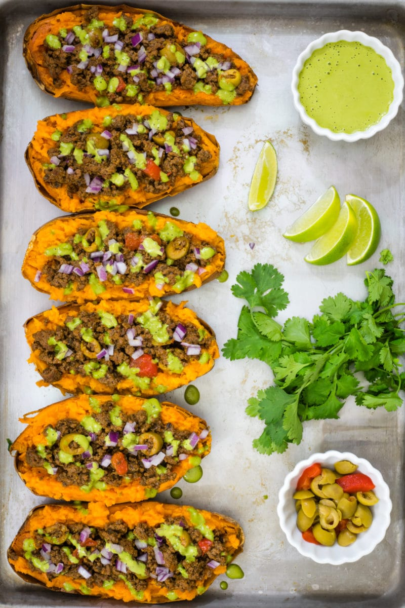 Stuffed sweet potatoes next to each other on a baking sheet